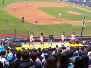 Mascot in the center, cheerleaders on the left and right.