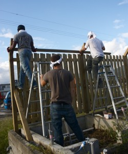 Team work! Building a custom fence. Photo courtesy of Grace.