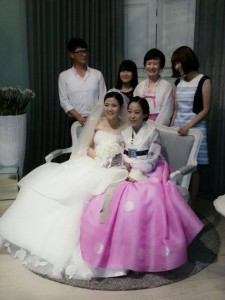 The bride with her sister (on the couch), brother in-law and in-law family.