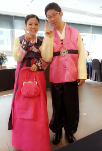 The bride in groom in traditional hanboks.