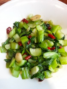 Sauteed bok choy, garlic and mushrooms, mixed with diced dried red chillies.