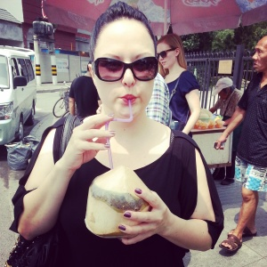 Enjoying fresh coconut water in Old Shanghai.