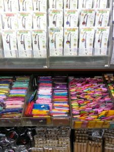 Change purses and make up bags made from hanbok material. Above them are bookmarks.