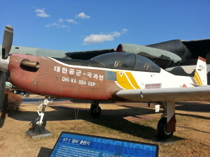 In front, the KT-1 Woongbi Trainer, used by the Korean military as a training aircraft. Behind, a B-52D Stratofortress Bomber, used by the US for strategic bombing operations.