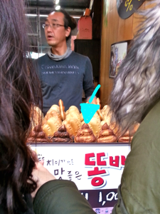 "Red bean breaded snacks, usually found in the shape of a fish. This vendor was selling them in the shape of pooh, or ""dong."" Serious."