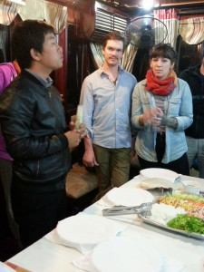 Kevin teaches our group how to make a traditional Vietnamese spring roll.