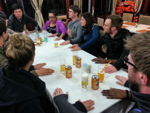 Kevin teaches us some traditional Vietnamese drinking games. We are all focused as we learn the rules.