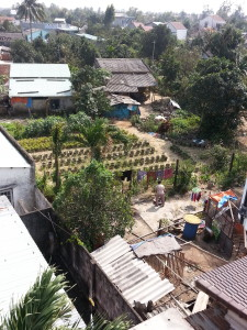 The view from our bedroom window at the Moon homestay, looking down on neighbouring backyards. Each had their own family of chickens and roosters!