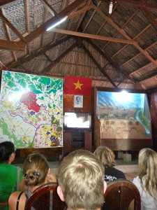 Our first meeting place where we sit with other tour groups to watch a propaganda video about the horrors of the Vietnam War. To the left is a map of the tunnels and to the right is a replica model to show the layers of tunnels used for different purposes.