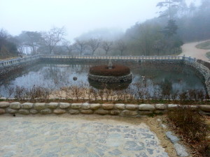 The foggy courtyard pond of Botajeon temple.