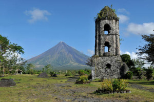 Mount Mayon Volcano and the ruins of Cagsaua church in Albay, Philippines. Courtesy of philippinetraveler.com